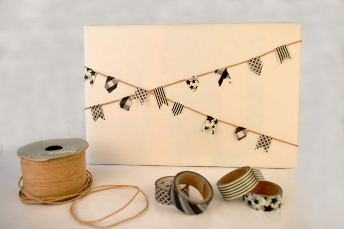 homemade gift wrap with flags on twine